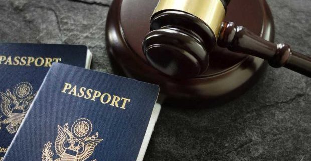 gavel-next-to-passports-representing-immigration-law-620x380